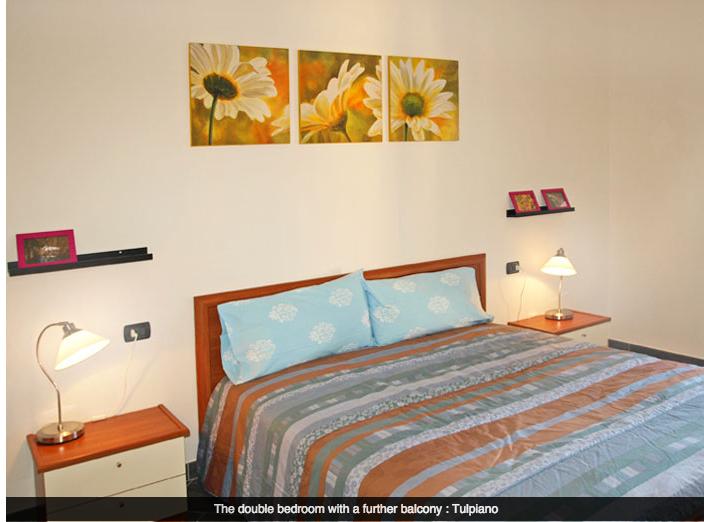 Slaapkamer van appartement Tulipano
