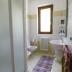 De badkamer beneden